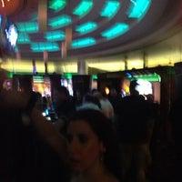 Photo taken at Xhibition Bar by Carlos V. on 3/16/2012