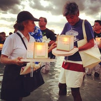 Photo taken at Memorial Day Lantern Floating Ceremony @ Ala Moana Beach Park by Kristine C. on 5/29/2012