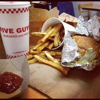 Photo taken at Five Guys by Julien A. on 7/21/2012