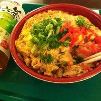 Photo taken at Sunrise Mart by Yuki S. on 4/5/2012