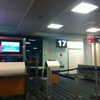 Photo taken at Gate 17 by Claudio A. on 1/13/2012