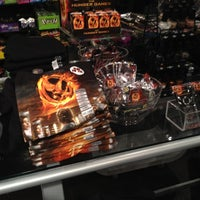 Photo taken at Hot Topic by Cathy K. on 2/23/2012
