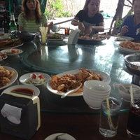 Photo taken at Ruangrit Seafood by Natthaset P. on 7/28/2012