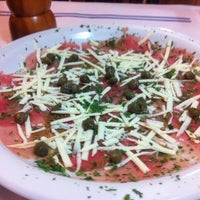 Photo taken at Rian Restaurante by Juliana J. on 5/11/2012