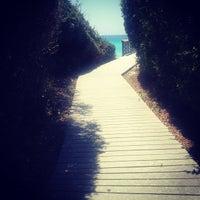 Photo taken at Blue Mountain Beach by Joanna T. on 5/20/2012