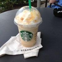 Photo taken at Starbucks by Ingrid M. on 7/18/2012