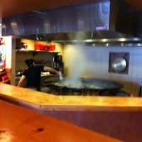 Photo taken at Genghis Grill by mike k. on 5/6/2012