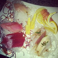 Photo taken at Blue Fin Sushi by lottie a. on 2/27/2012