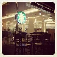 Photo taken at Starbucks by Panrawee P. on 3/2/2012