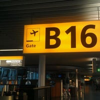 Photo taken at Gate B16 by Kevin T. on 5/30/2012