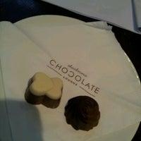 Photo taken at Theobroma Chocolate Lounge by Joyce C. on 4/7/2012