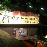 Photo taken at Tapeo Restaurant and Tapas Bar by Margot on 10/21/2011