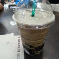 Photo taken at Starbucks by Romeo I. on 7/26/2012