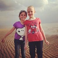 Photo taken at Caldy Beach by John N. on 4/13/2012