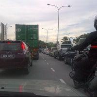 Photo taken at Traffic Light Jalan Salleh by Khalis M. on 6/8/2012