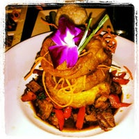 Photo taken at Osha Thai Noodle Cafe by Eugênio L. on 4/6/2012