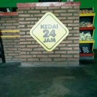 Photo taken at Kedai 24 Jam by rheza r. on 2/17/2012
