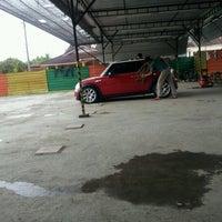 Photo taken at Mutiara Car Wash by Ebby M. on 1/9/2012