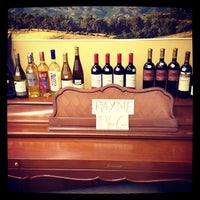 Photo taken at Downtown Wine & Spirits by Lou P. on 1/28/2012