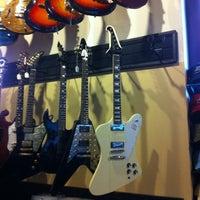 Photo taken at Gruhn Guitars by Chris D. on 3/1/2012