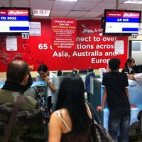 Photo taken at Thai AirAsia Counter by Nree T. on 4/14/2011