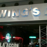 Photo taken at Wings Army by Edgar R. on 12/30/2011