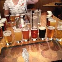 Photo taken at Rock Bottom Restaurant & Brewery by Bianca on 7/2/2012