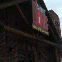 Photo taken at Smokey Bones Bar & Fire Grill by Jessica K. on 7/20/2012