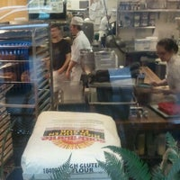 Photo taken at Specialty's Café & Bakery by Maria on 4/11/2012