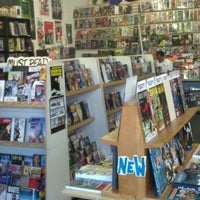Photo taken at Ash Avenue Comics and Books by Justin W. on 8/25/2011