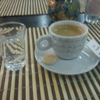 Photo taken at Café Petit by Nivaldo F. on 9/20/2011