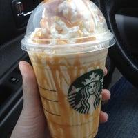 Photo taken at Starbucks by Carli S. on 3/21/2012