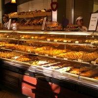 Photo taken at Porto's Bakery & Cafe by Samantha D. on 2/10/2012