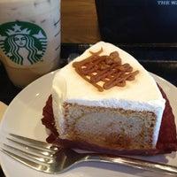 Photo taken at Starbucks Coffee 神田駅前店 by Nobuyuki K. on 8/22/2012