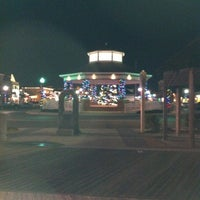 Photo taken at Rehoboth Beach Bandstand by Kymmr B. on 12/21/2011