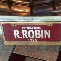 Photo taken at Red Robin Gourmet Burgers by Malika A. on 3/17/2012