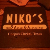 Photo taken at Niko's Steakhouse by Isaac G. on 11/27/2011