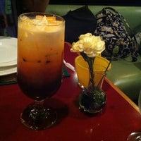 Photo taken at Thai Basil Restaurant by Grace K. on 9/24/2011