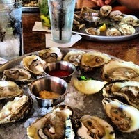 Photo taken at Mahi Mah's Seafood Restaurant by katrina j. on 8/22/2012