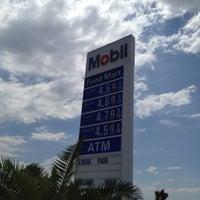 Photo taken at Mobil by Tetsuya K. on 7/22/2012