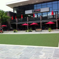 Photo taken at Atlantic Station Central Lawn by Ken B. on 8/5/2012
