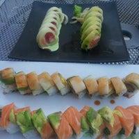 Photo taken at Piranha Killer Sushi by Jake B. on 4/1/2012