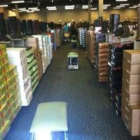 Photo taken at DSW Designer Shoe Warehouse by Franny R. on 9/6/2012