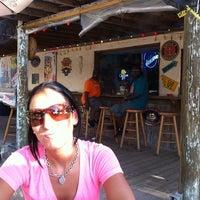 Photo taken at Cruzan Rum Bar by Mike K. on 8/21/2011