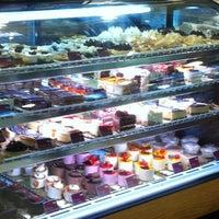 Photo taken at Miga's by Daniela M. on 6/16/2012