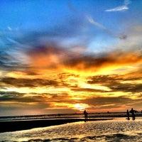 Photo taken at Pantai Saujana (Pantai Batu Empat) by Azfar Y. on 3/31/2012