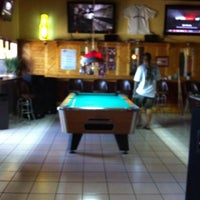 Photo taken at Conch Town Liquor & Lounge by Dawn Marie K. on 4/26/2011