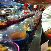 Photo taken at Okiru Running Sushi by Bahattin E. on 3/2/2012