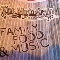 Photo taken at The Mojo Grill by Liz J. on 3/4/2012