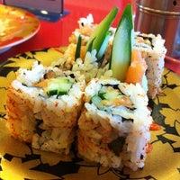 Photo taken at Sushi Kiosk! by Sushi Tei by gladys r. on 7/19/2012